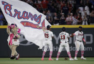 Atlanta Braves outfielders Cristian Pache (25), Ronald Acuna Jr. (13) and Marcell Ozuna, right, celebrate the team's 6-1 victory over the Philadelphia Phillies at the end of a baseball game Sunday, May 9, 2021, in Atlanta. (AP Photo/Ben Margot)