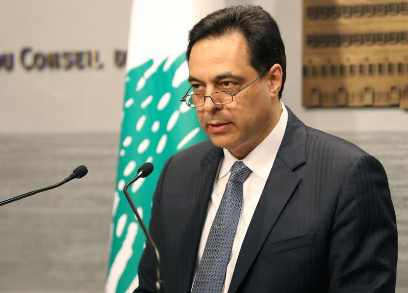 Lebanon's Prime Minister Hassan Diab speaks during a televised address to the the nation at the governmental palace in Beirut