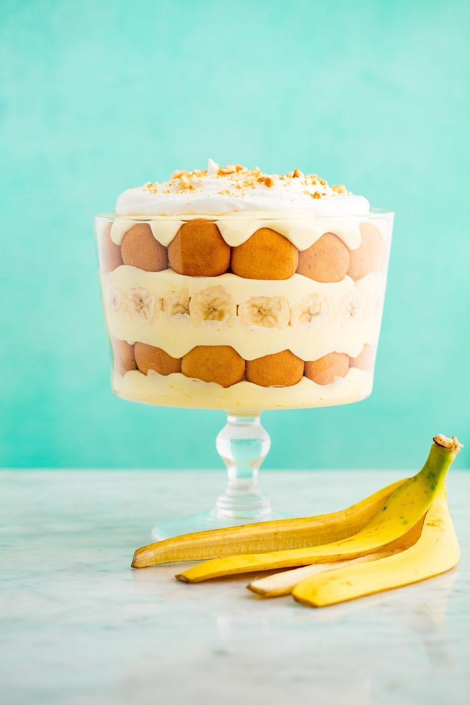 """<p>Making a layered trifle pudding like this isn't difficult at all; it's cascading layers of pudding, whipped cream, bananas, and wafers simply arranged atop each other. It's just as delicious if arranged in individual servings, too.</p><p><a href=""""https://www.delish.com/cooking/recipe-ideas/recipes/a52780/banana-pudding-cheesecake-recipe/"""" rel=""""nofollow noopener"""" target=""""_blank"""" data-ylk=""""slk:Get the recipe from Delish »"""" class=""""link rapid-noclick-resp""""><em>Get the recipe from Delish »</em></a></p>"""