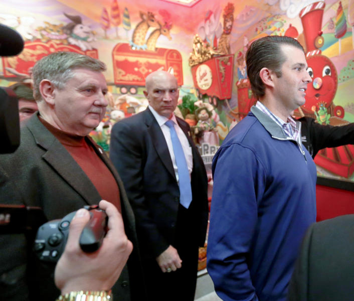 Republican Rick Saccone, left, and Donald Trump Jr., tour Sarris Candies during a campaign stop, Monday, March 12, 2018 in Canonsburg, Pa. Saccone is running against Democrat Conor Lamb in a special election being held on March 13 for the PA 18th Congressional District vacated by Republican Tim Murphy. (AP Photo/Keith Srakocic)