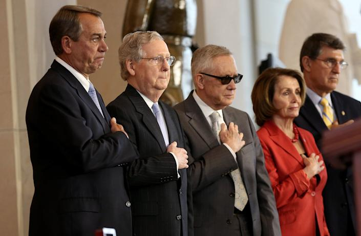 From left: U.S. Speaker of the House John Boehner (R-Ohio), Senate Majority Leader Mitch McConnell (R-Ky.), Senate Minority Leader Harry Reid (D-Nev.), House Minority Leader Nancy Pelosi (D-Calif.) and Sen. Joe Manchin (D-W.Va.) place their hands over their hearts during the playing of the national anthem during a presentation ceremony for the Congressional Gold Medal in recognition of the American Fighter Aces' service to the United States at the U.S. Capitol on May 20, 2015. Congress honored the service of the pilots with the highest civilian honor Congress can bestow.