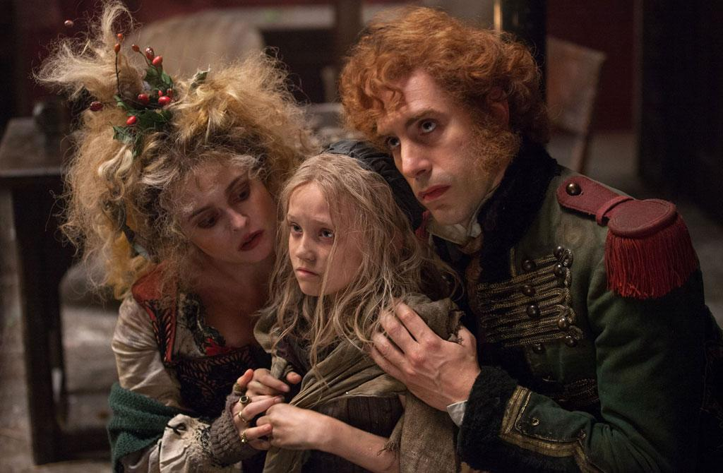 "Helena Bonham Carter, Sacha Baron Cohen and Isabelle Allen in Universal Pictures' ""Les Miserables"" - 2012"