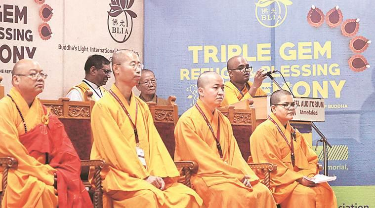 Buddhist monks at an event organised by Gujarat chapter of Buddha's Light International Association, an international Buddhist organisation, in Ahmedabad, on Sunday. (Express Photo: Javed Raja)