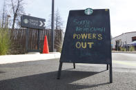 FILE - In this Oct. 24, 2019, file photo, a sign at the entrance of the drive-thru at Starbucks warns customers the store is closed due to a power blackout in Paradise, Calif. When Pacific Gas & Electric set up emergency operations centers to coordinate intentional blackouts intended to prevent wildfires in Northern California, the nation's largest utility forgot one thing, emergency managers who knew the fundamentals of emergency management in California. (AP Photo/Rich Pedroncelli, File)