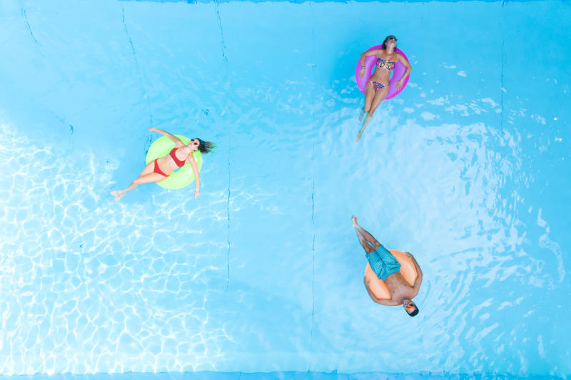 People relaxing at swimming pool