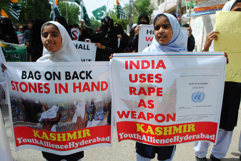 Pakistani students rally to express solidarity with Indian Kashmiris in Hyderabad, Pakistan, Friday, Sept. 13, 2019. The protests and anti-India rallies continued in solidarity with Kashmiri people after the controversial bill was passed by India shrinking the rights of Kashmir people. (AP Photo/Pervez Masih)