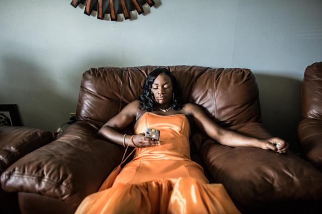 "<p>Claressa ""T-Rex"" Shields waits to be picked up by her boyfriend before her senior prom in Flint, Michigan. This is nearly a year after winning the Olympic Gold Medal in Women's Boxing at the 2012 Summer Games in London. (Photograph by Zackary Canepari) </p>"