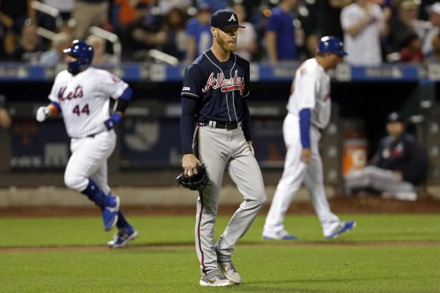 Atlanta Braves pitcher Mike Foltynewicz reacts after giving up a two-run home run to New York Mets' Rene Rivera (44) during the third inning of a baseball game, Saturday, Sept. 28, 2019, in New York. (AP Photo/Adam Hunger)