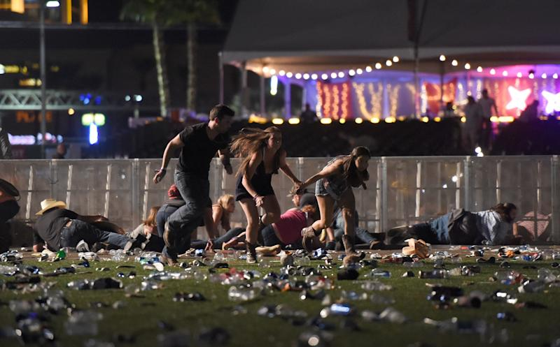 Fans run from the Route 91 Harvest festival after a gunman opened fire.
