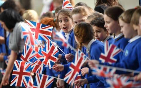 "Prince Harry and Meghan Markle are celebrating International Women's Day by encouraging schoolgirls to break down gender stereotypes by pursuing careers in science, maths and engineering. The Royal couple travelled to Birmingham to attend an event where young women are taking part in a range of activities from speed networking opportunities with local businesses to a panel discussion. The couple were greeted by John Crabtree, Lord Lieutenant of the West Midlands. Ms Markle wore a coat by J Crew, trousers by Alexander Wang and an All Saints jumper. Harry and Meghan went on a walkabout shaking hands and greeting around 300 well-wishers and school children who had waited patiently to meet them. Two elderly sisters, Irene Gould, 82, and her younger sibling June Dickinson, 78, were also ecstatic after meeting Harry and his fiancee. Mrs Gould said: ""We were just so pleased to meet them, and how beautiful Meghan is. We thanked Harry for coming to see us and wished them all the best for their marriage."" Prince Harry and Meghan Markle chat to two women on their visit to Birmingham Credit: Victoria Jones /PA Student Charlotte Highsmith, from Oxford, was overcome with excitement after meeting Meghan and said: ""Oh my God, it was worth the wait - I've missed my lecture."" The 20-year-old, who is studying criminology and policing at Birmingham City University, added: ""Meghan just thanked us for waiting in the rain for her, but it wasn't a problem."" The visit is the latest leg in the regional tours the prince and his fiancee are undertaking in the run-up to their May wedding, and follows trips to Edinburgh, Nottingham, Cardiff and Brixton in south London. Meghan Markle talks to children as she arrives in Birmingham Credit: Chris Jackson /Getty The events are giving Ms Markle a personal education in the issues faced in parts of the UK and nationally, and complement the private visits she is regularly making to organisations as she gets to know the UK charity sector. Thursday's highly-anticipated visit comes after it emerged Ms Markle has reportedly been baptised and confirmed in the Church of England at a private ceremony led by the Archbishop of Canterbury. Birmingham's visit began with the now familiar walkabout before Harry and Ms Markle chatted to young women as they took part in building apps and touchpads, before hearing more about their motivations to pursue science, technology, engineering and maths (Stem) subjects. Prince Harry beams as he chats to children in Birmingham Credit: Heathcliff O'Malley for The Telegraph Hosted by social enterprise Stemettes at Millennium Point, the event also offers information on work experience, apprenticeships, A-level choices, and university degrees in Stem topics. Harry and Ms Markle started the event by trying virtual headsets with students from Blessed Edward Oldcorne School in Birmingham. The couple tried on the headsets, which resembled a virtual rollercoaster. Ms Markle asked the students what they wanted to do as a career and was impressed with the answers of surgeons and doctors. The pupils described the experience as surreal after the couple shook their hands and went on to other workshops. Meghan Markle hugs a schoolgirl in Birmingham Credit: Heathcliff O'Malley for The Telegraph After finishing talking through various pieces of technology with the students, the pair sat together to listen to speeches from inspiring women in Stem industries. Ms Markle was shocked by some of the technology on display, including pianos made out of bananas and how to ""hack the web"". She told some students that the coding they were working on was very impressive, saying: ""Wow, that's really cool."" Meghan Markle chats to youngsters Credit: Heathcliff O'Malley for The Telegraph Prince Harry shared his finance's thoughts and encouraged the talented students to go into careers in science and maths. The couple left the event after both were given a goody bag which said: ""I am not just a bag, I am a Stemettes bag."" They received a huge round of applause from the 90 female students as they made their way to their next event. The couple also gave prizes to three winners of a speech-writing competition in which they spoke about their most inspiring women. Harry and Ms Markle nodded in approval after each of the speeches and gave all three a generous clap at the end. Meghan Markle kneels as he chats to flag-waving children Credit: Heathcliff O'Malley for The Telegraph The Coach Core apprenticeship scheme was designed by the Royal Foundation of the Duke and Duchess of Cambridge and Prince Harry to train people aged 16 - 24 with limited opportunities to become sports coaches and mentors within their communities. During the year-long apprenticeship, which now operates in 10 cities across the UK, young people learn technical sport skills alongside an inclusive and holistic approach to coaching, with an emphasis on employability and mentoring skills. Ms Markle is due to become the fourth patron of the Royal Foundation when she marries the prince and the couple will chat to the apprentices about their experiences of the programme, launched in Birmingham in March last year, before joining them in the sports hall as they deliver practice training sessions. Royal well-wishers brave cold to greet couple Well-wishers began gathering hours before the prince and his bride-to-be were due to appear at Millennium Point. Despite the cold and wet conditions some in the crowds were eagerly awaiting the arrival of the couple who have been touring the nation since their engagement announcement last year. Stephen McNally, 61, from Stourbridge, said he travelled with a group of friends with many of them carrying bouquets for Ms Markle. Children wave flags as they wait to catch a glimpse of the royal couple Credit: Joe Giddens/PA Commenting on Harry's engagement to the American actress he said: ""It will be different for her but I think they've learnt a lot from the past and that is why Meghan is doing these walkabouts and going round the country before she's getting married, I think it's really nice, rather than keeping things a secret like they used to do. ""We hope to be going to Windsor for the wedding, on the streets or in the castle precinct."" Schoolchildren await the arrival of Prince Harry and Meghan Markle Credit: Joe Giddens/PA Retired teacher Josie Weeks, 62, from Leeds, got up at 5am to travel to Birmingham for the royal visit and carried a posy of white blooms for Ms Markle. She said: ""I met the couple in Nottingham and just wanted to see them again and take some photographs. I think Harry's really coming into himself now with his charity work - he's stepped it up in the last few years. ""The main thing is if he's happy with Meghan, that's all you want for him."" Prince Harry: 'We want to get away from idea it's all men in overalls and oily rags' On Wednesday, Prince Harry met young people from the Williams F1 Engineering Academy during a visit to Silverstone. Talking to female students Tara Vooght and Lauren Bull, both 15, who are studying there with the hope of going on to be engineers, he told them: ""It's a great choice, we want to get away from [the idea] that it's all men in overalls and oily rags. ""Do you think think that girls want to be [in engineering] and there aren't opportunities or it is not really considered by them?"" ""There are a lot of stereotypes,"" said Tara. ""What men covered in grease?"" asked Harry. ""Yes, but it's not like that. There was a bit of adjustment at first from being at school but we are loving it."" Duchess of Cornwall also marking International Women's Day The couple are not the only members of the Royal Family to mark International Women's Day. The Duchess of Cornwall will host a reception at Clarence House to celebrate the day, in her role as president of the Southbank Centre's Women of the World festival. Women Mean Business 