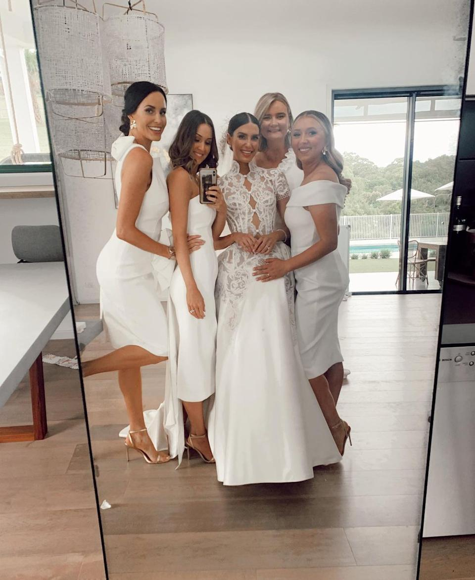Erin Holland wearing a wedding dress with her bridesmaids Lauren Vickers, Lucy Turner, Margarita Nazarenko and Rachel Khawaja