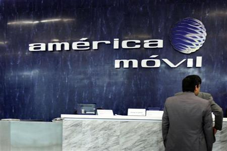 The logo of America Movil is seen on the wall of the reception area in the company's corporate offices in Mexico City