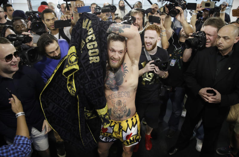 Conor McGregor puts on his robe after a workout in front of the media, Friday, Aug. 11, 2017, in Las Vegas. McGregor is scheduled to fight Floyd Mayweather Jr. in a boxing match Aug. 26 in Las Vegas. (AP Photo/John Locher)