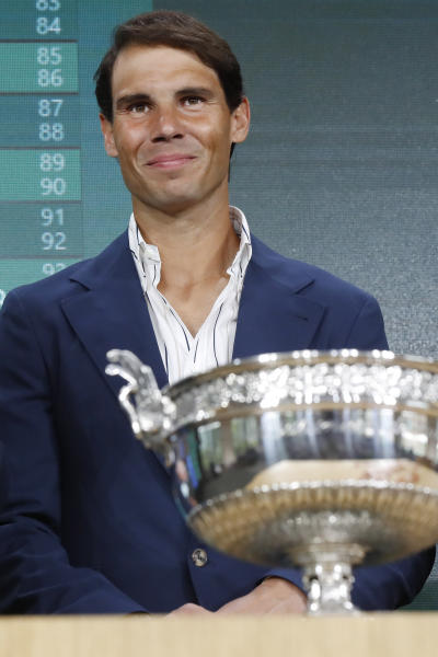 Defending champion Spain's Rafael Nadal poses next to the cup during the draw of the French Open tennis tournament at the Roland Garros stadium in Paris, Thursday, May 23, 2019. The French Open tennis tournament starts Sunday May 26. (AP Photo/Michel Euler)