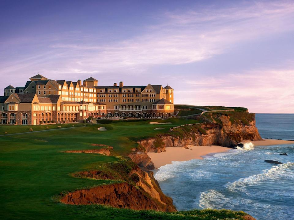 "<p><strong>Why did this hotel catch your attention?</strong> Perched on the rugged cliffs along the Pacific coastline, The Ritz Carlton Half Moon Bay is a hotel you can easily imagine being somewhere on the East Coast or even on the Scottish bluffs. The 261-room resort overlooks the magnificent ocean, golf courses and has access to trails and beaches. Just a short 50-minute drive from <a href=""https://www.cntraveler.com/destinations/san-francisco?mbid=synd_yahoo_rss"" rel=""nofollow noopener"" target=""_blank"" data-ylk=""slk:San Francisco"" class=""link rapid-noclick-resp"">San Francisco</a> or Silicon Valley, it's perfect for romantic getaways.</p> <p><strong>What's the backstory?</strong> Opened in 2002, this is one of the few resorts, perhaps the only resort, of this size and scale located directly on Northern California's shoreline. The Shingle style architecture of the hotel, which is much more common on the East Coast, comes from trying blend a building into the coast's asymmetrical landscape.</p> <p><strong>Tell us all about the accommodations. Any tips on what to book?</strong> The nautical details you would expect at a hotel set on the water are used very sparingly, which is very appreciated. The standard rooms are decorated in hues of gray, bright blue, and slate, hinting at coastal accents. There is a natural calm breezing through the rooms that comes from their isolated location. Ground floor rooms with private fire pits and the extra deep bathtubs are perfect for a full body soak. </p> <p><strong>Is there a charge for Wi-Fi?</strong> The Wi-Fi is good while you are in the hotel, outside you quickly lose the connection. But hey, isn't it why you are here? To disconnect?</p> <p><strong>Drinking and dining—what are we looking at?</strong> There are three restaurants here. The Conservatory, mimicking a modern beach house, is great for a casual breakfast, lunch, or dinner, while the Ocean Terrace features an oyster bar and grilled specialties. But the real star is Navio, the acclaimed restaurant from Chef Jakob Esko that focuses on coastal flavors. The restaurant hosts the Global Cuisine Series, welcoming other internationally acclaimed chefs as well. You get greeted with a glass of wine at the check-in, and the front desk staff is efficient and super friendly. If you need an itinerary, the concierge will be more than happy to organize everything for you - from horseback riding to kayaking.</p> <p><strong>And the service?</strong> You're greeted with a glass of wine at check-in and the front desk staff is efficient and friendly. If you need an itinerary, the concierge will be more than happy to organize outings like horseback riding or kayaking for you.</p> <p><strong>Who else stays here?</strong> There are many folks in their best resort-casual attire, but also surprisingly, many young professionals in Patagonia vests from all over Silicon Valley. Since Northern California has a laid-back vibe anyway, you are just fine in anything but a pair of old sweats.</p> <p><strong>Any other hotel features worth noting?</strong> Around sunset time, a bagpiper creates a magical experience on the cliffs. This is the moment where you genuinely feel like you could be in Scotland.</p>"