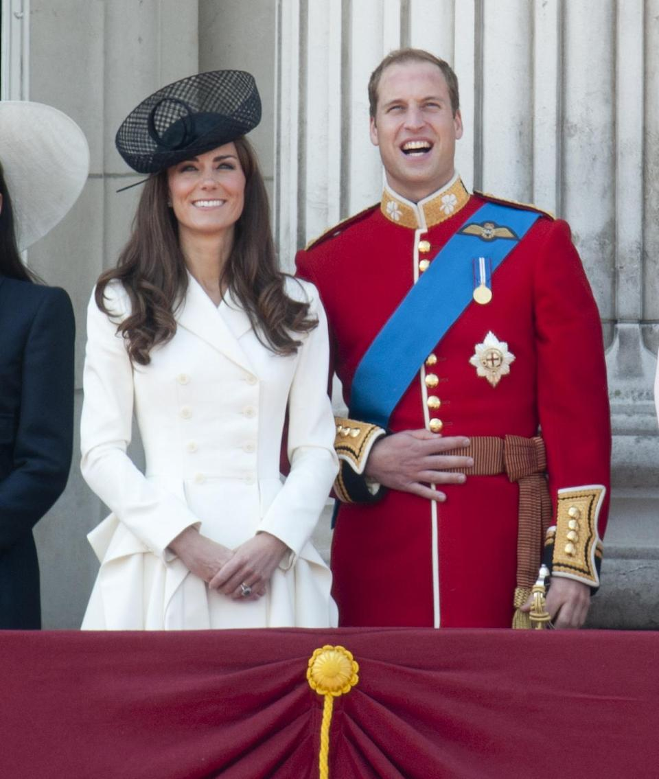 Shortly after their wedding, the Duke and Duchess of Cambridge graced the Buckingham Palace balcony. For the prestigious occasion, Kate Middleton donned a bespoke cream dress by Alexander McQueen. (Getty Images)