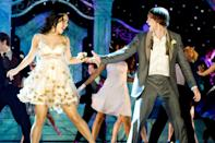 "<p>Not only did Gabriella get to dance with her boyfriend Troy Bolton at prom, but she also got to wear a super sweet chiffon dress with appliqué flowers that looked best mid-twirl.</p><p><a class=""link rapid-noclick-resp"" href=""https://www.amazon.com/High-School-Musical-Senior-Year/dp/B003QSEKTU?tag=syn-yahoo-20&ascsubtag=%5Bartid%7C10063.g.36197518%5Bsrc%7Cyahoo-us"" rel=""nofollow noopener"" target=""_blank"" data-ylk=""slk:STREAM NOW"">STREAM NOW</a></p>"