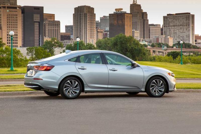 This photo provided by Honda shows the 2019 Honda Insight Hybrid. Car shoppers seeking high fuel economy have two particularly intriguing choices this year: the Honda Insight and the Toyota Corolla Hybrid. Both deliver an EPA-estimated 52 mpg in combined city and highway driving, which is among the best of any vehicle on sale.  (Honda via AP)