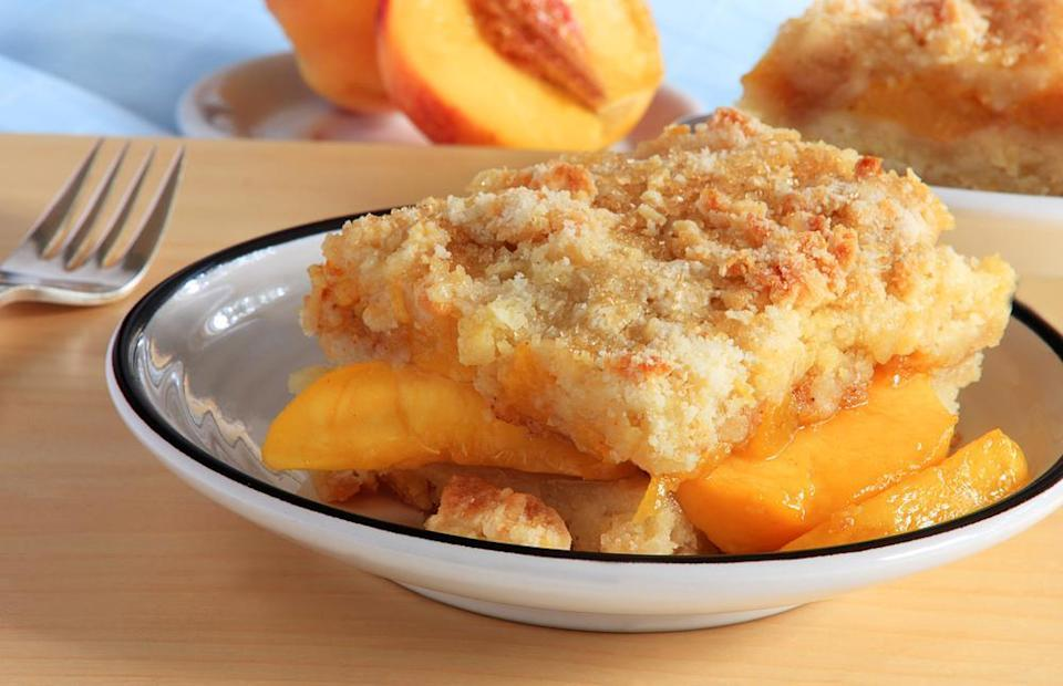 """<p>You can make this old-fashioned peach cobbler using <a href=""""https://www.thedailymeal.com/cook/pantry-staple-recipes-easy?referrer=yahoo&category=beauty_food&include_utm=1&utm_medium=referral&utm_source=yahoo&utm_campaign=feed"""" rel=""""nofollow noopener"""" target=""""_blank"""" data-ylk=""""slk:the ingredients you already have in your pantry"""" class=""""link rapid-noclick-resp"""">the ingredients you already have in your pantry</a>. Choose fresh, frozen or canned peaches to create this classic.</p> <p><a href=""""https://www.thedailymeal.com/recipes/old-fashioned-peach-cobbler?referrer=yahoo&category=beauty_food&include_utm=1&utm_medium=referral&utm_source=yahoo&utm_campaign=feed"""" rel=""""nofollow noopener"""" target=""""_blank"""" data-ylk=""""slk:For the Old-Fashioned Peach Cobbler recipe, click here."""" class=""""link rapid-noclick-resp"""">For the Old-Fashioned Peach Cobbler recipe, click here.</a></p>"""