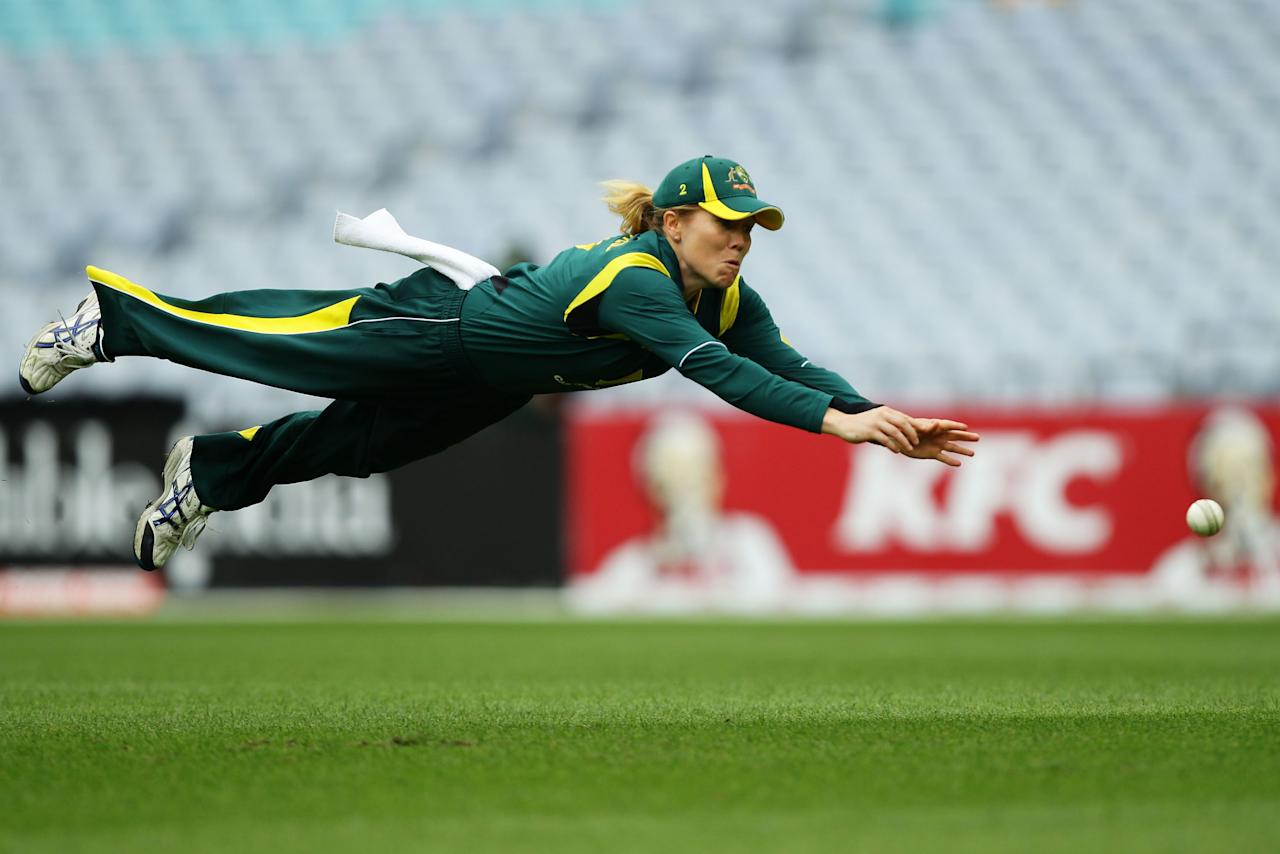 SYDNEY, AUSTRALIA - FEBRUARY 01:  Alex Blackwell of Australia dives for an unsuccessful catch during the women's International Twenty20 match between the Australian Southern Stars and New Zealand at ANZ Stadium on February 1, 2012 in Sydney, Australia.  (Photo by Matt King/Getty Images)