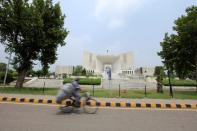 A man rides a bicycle past the Supreme Court building in Islamabad