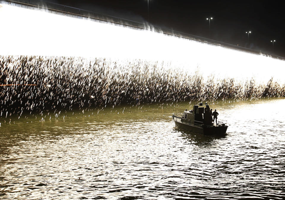 A Serbian police boat cruises on Sava river during Red Star fans celebrate after their team won the Serbian soccer league title in Belgrade, Serbia, Saturday, May 22, 2021. (AP Photo/Darko Vojinovic)