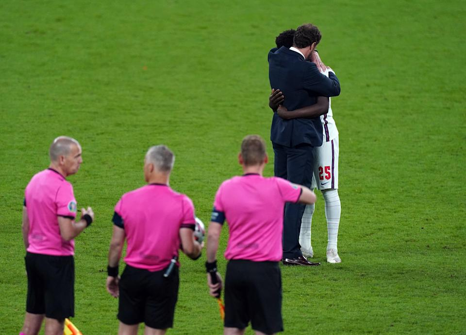 England manager Gareth Southgate consoled Saka after the penalty shoot out (Mike Egerton/PA) (PA Wire)