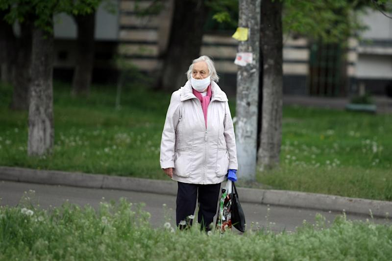 KYIV, UKRAINE - MAY 6, 2020 - An elderly woman in a face mask is seen on a street during the quarantine imposed due to the coronavirus pandemic, Kyiv, capital of Ukraine.- PHOTOGRAPH BY Ukrinform / Barcroft Studios / Future Publishing (Photo credit should read Evgen Kotenko/ Ukrinform/Barcroft Media via Getty Images)