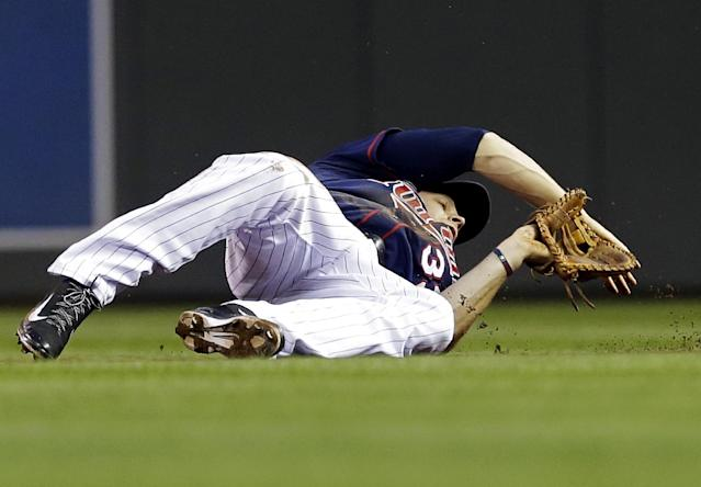 Minnesota Twins' Justin Morneau makes a diving try to no avail as Chicago White Sox' Avisail Garcia singles past him in the fourth inning of a baseball game, Thursday, Aug. 15, 2013, in Minneapolis. (AP Photo/Jim Mone)