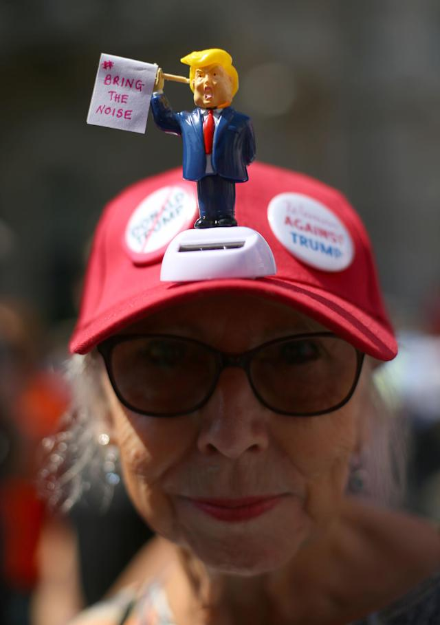 <p>Protesters for the 'Stop Trump' Women's March pass through London, as part of the protests against the visit of US President Donald Trump to the UK. (Photo: Yui Mok/PA Images via Getty Images) </p>
