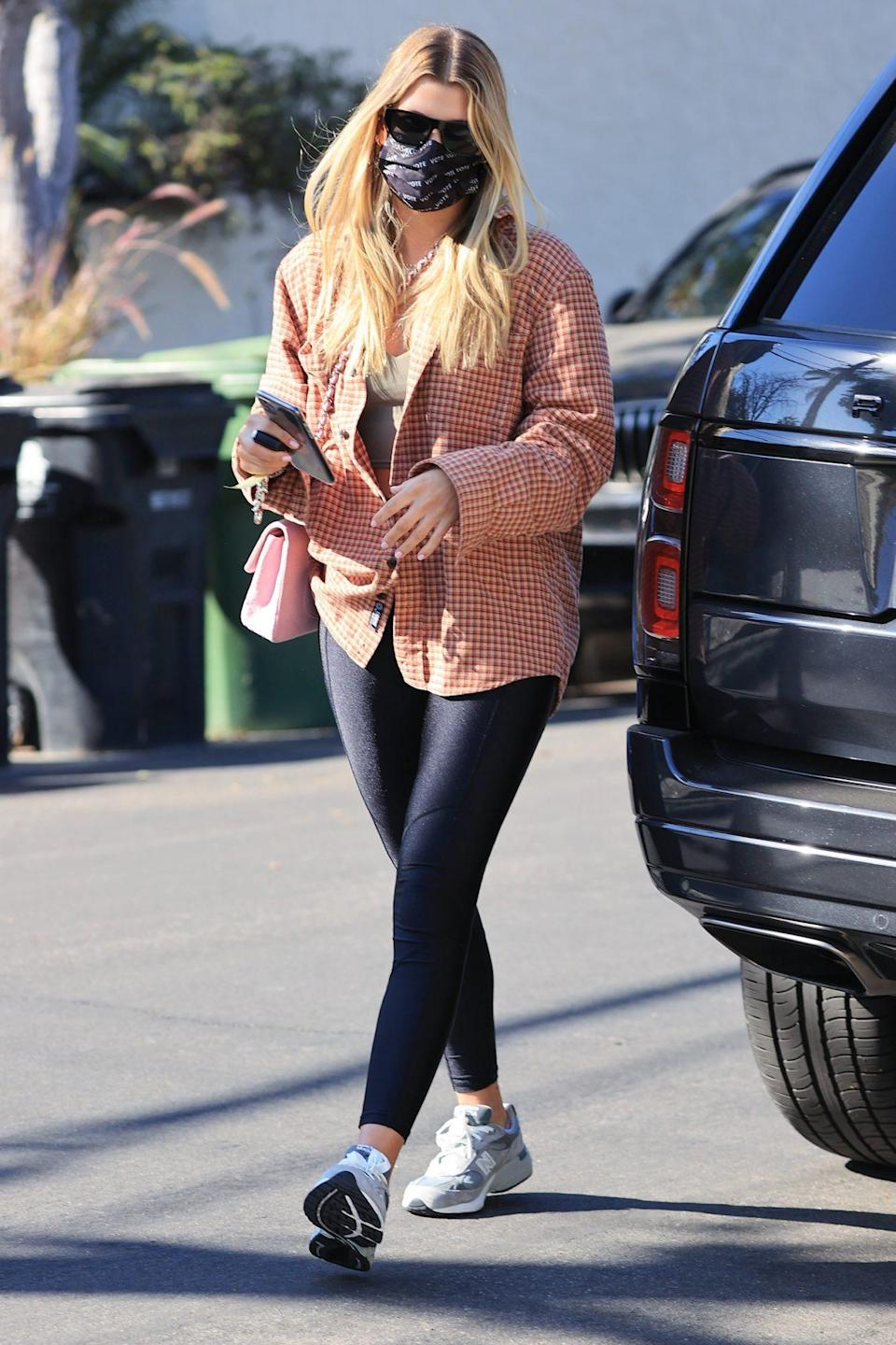 <p>Sofia Richie pairs a plaid coat and leggings, then heads out to a friend's house in L.A. on Wednesday.</p>