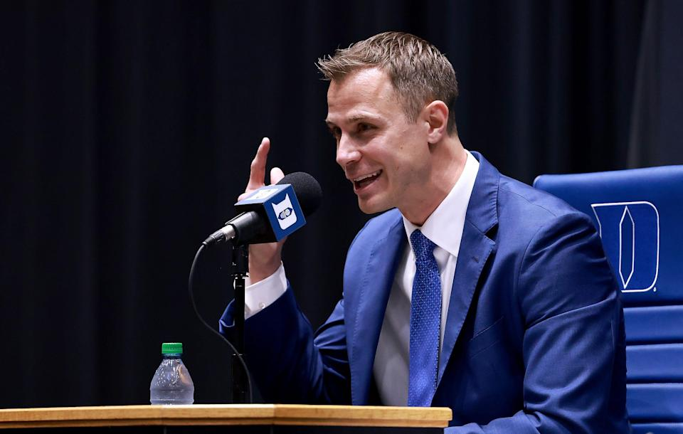 Jon Scheyer speaks after being named the 20th coach of the Duke men's basketball team during a news conference at Cameron Indoor Stadium.