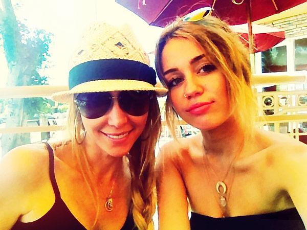 Miley Cyrus: Competing With Her Mom Tish For The Sexiest Outfit?