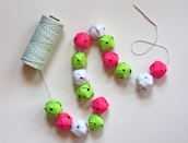 "<p>Make these jingle-bell-esque balls from paper in any colors you like. String them from baker's twine like a garland, or glue onto a wreath form.</p><p><em><a href=""http://howaboutorange.blogspot.com/2011/12/make-garland-from-woven-paper-balls.html"" rel=""nofollow noopener"" target=""_blank"" data-ylk=""slk:Get the tutorial at How About Orange»"" class=""link rapid-noclick-resp"">Get the tutorial at How About Orange»</a></em><br></p>"