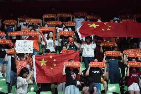 Table Tennis - China Open tournament - Chengdu, China - June 24, 2017 - China's table tennis fans hold up banners to support Liu Guoliang, who has been removed from his coaching place, during the China Open tournament. Picture taken June 24, 2017. REUTERS/Stringer