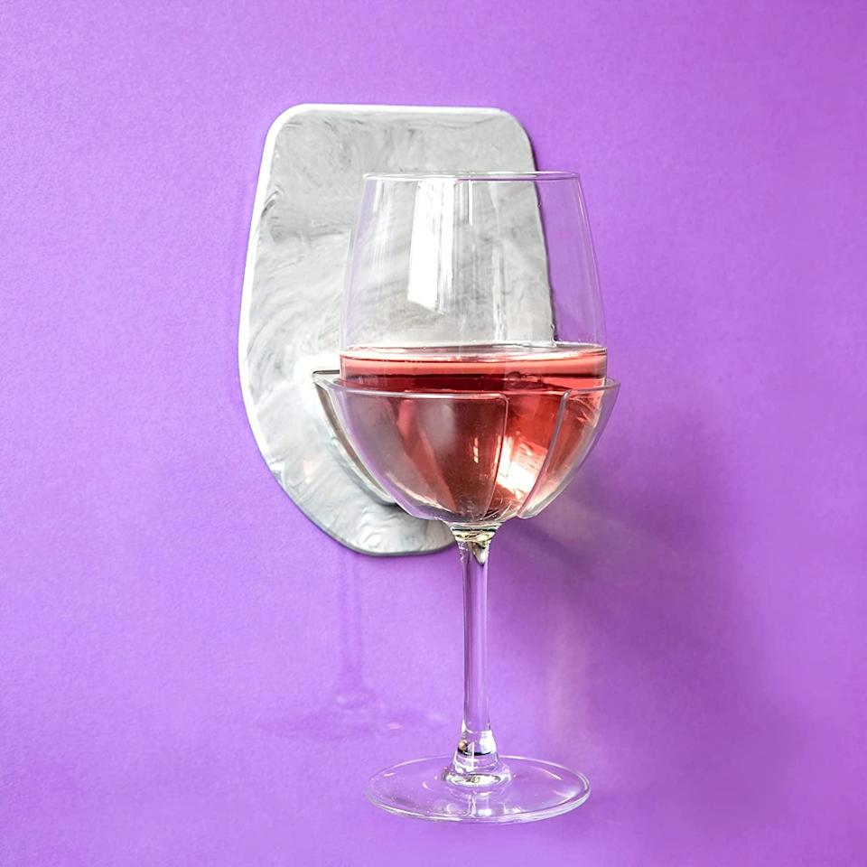 <p>The best way to level up their shower time is to get them this <span>30 Watt Sudski Silicone Wine Glass Holder</span> ($9, originally $20). They'll be able to unwind with their favorite glass in the shower. If they love beer, get them this <span>30 Watt Sudski Portable Shower Beer Can Holder</span> ($12, originally $15). Both come in a variety of colors. </p>