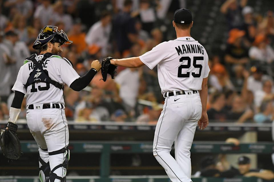 Detroit Tigers catcher Eric Haase, left, fist-bumps starting pitcher Matt Manning after the top of the fifth inning of the team's baseball game against the Toronto Blue Jays, Friday, Aug. 27, 2021, in Detroit.