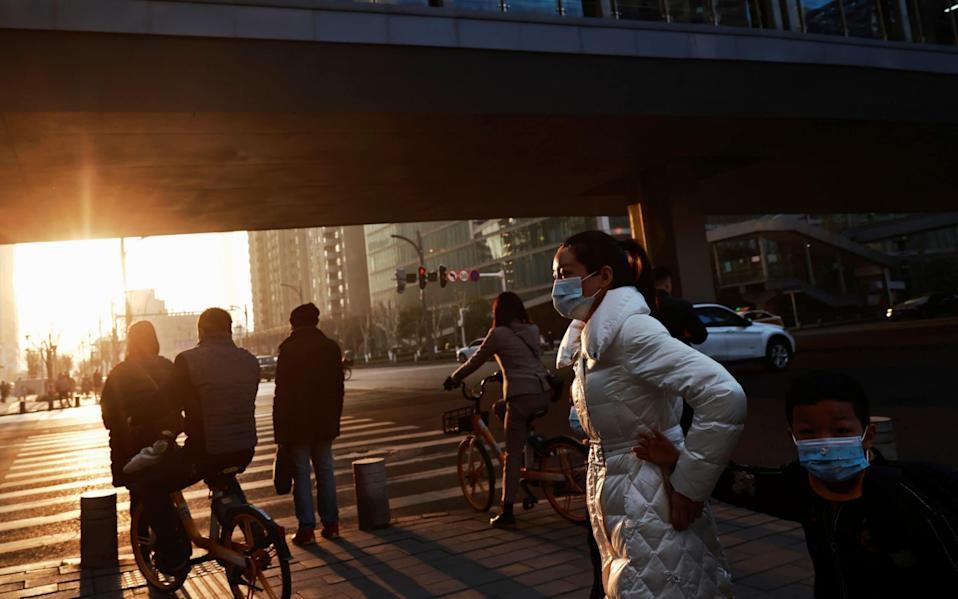 China has been blamed for failing to contain the spread of Covid-19 which has become a global pandemic - REUTERS