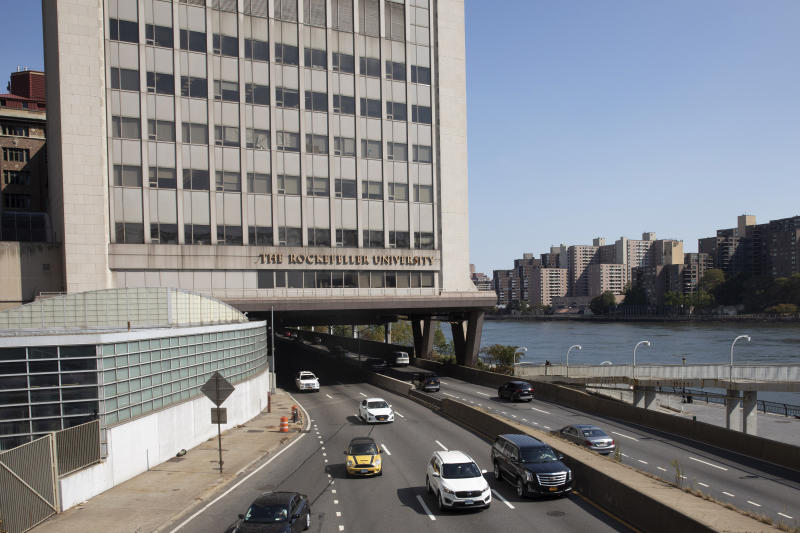 In this Sept. 26, 2019, photo, cars pass Rockefeller University in New York. Prestigious universities around the world, including Rockefeller, have accepted at least $60 million over the past five years from the family that owns the maker of OxyContin, even as the company became embroiled in lawsuits related to the opioid epidemic, financial records show. Rockefeller accepted more money from the Sacklers than any other school in recent history. (AP Photo/Mark Lennihan)