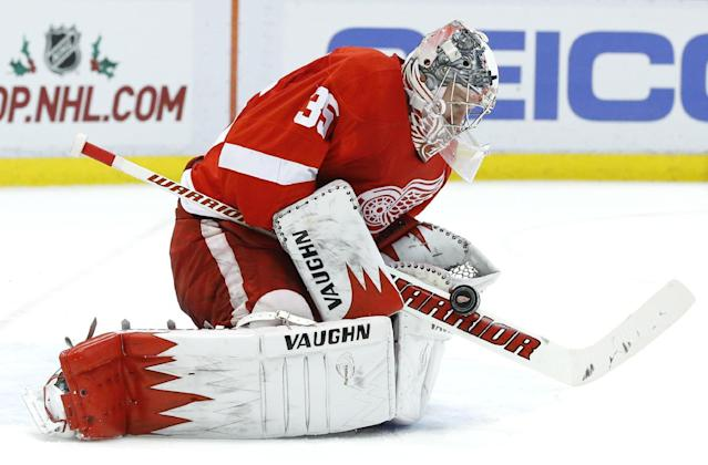 Detroit Red Wings goalie Jimmy Howard (35) stops a Philadelphia Flyers shot in the first period of an NHL hockey game in Detroit, Wednesday, Dec. 4, 2013. (AP Photo/Paul Sancya)
