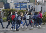 Students arrive at school in Le Chesnay, west of Paris, Modnay, May 3, 2021. Students go back to secondary and high schools and a domestic travel ban will end. The French government is slowly starting to lift partial lockdowns, despite still high numbers of coronavirus cases and hospitalized COVID-19 patients. (AP Photo/Michel Euler)