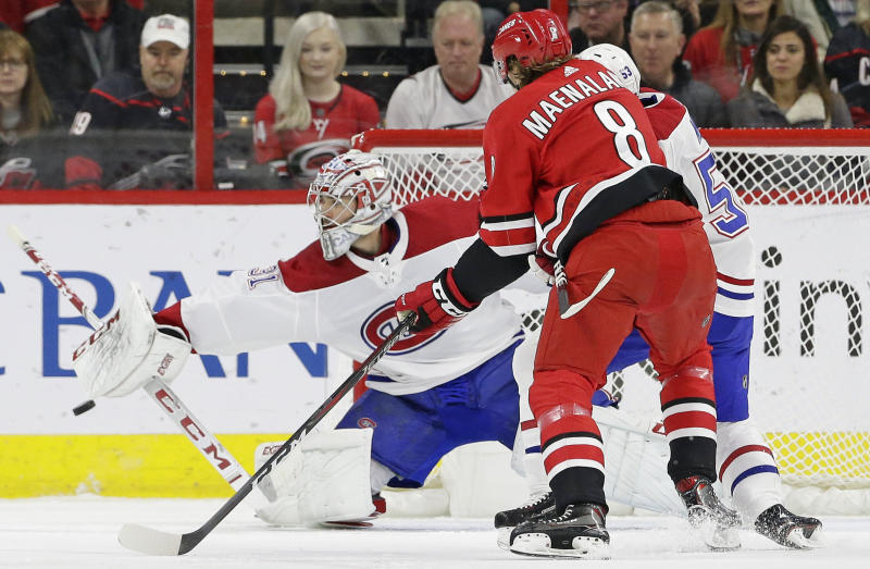 Montreal Canadiens goalie Carey Price (31) blocks Carolina Hurricanes' Saku Maenalanen (8), of Finland, during the first period of an NHL hockey game in Raleigh, N.C., Sunday, March 24, 2019. (AP Photo/Gerry Broome)