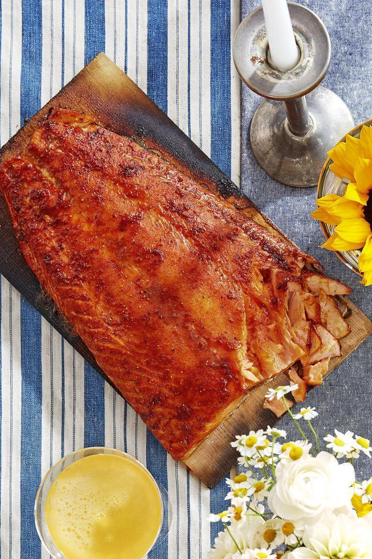 """<p>Who says you need to have a Christmas ham? Go for a lighter entrée, like this absolutely delicious salmon dish. To keep it keto, be sure to use a brown sugar substitute.</p><p><strong><a href=""""https://www.countryliving.com/food-drinks/a22665225/sweet-and-smoky-cedar-planked-salmon-recipe/"""" rel=""""nofollow noopener"""" target=""""_blank"""" data-ylk=""""slk:Get the recipe"""" class=""""link rapid-noclick-resp"""">Get the recipe</a>.</strong></p><p><strong><a class=""""link rapid-noclick-resp"""" href=""""https://www.amazon.com/Sukrin-Gold-Natural-Brown-Alternative/dp/B01ARKFXVS/?tag=syn-yahoo-20&ascsubtag=%5Bartid%7C10050.g.33537379%5Bsrc%7Cyahoo-us"""" rel=""""nofollow noopener"""" target=""""_blank"""" data-ylk=""""slk:SHOP BROWN SUGAR SUBSTITUTES"""">SHOP BROWN SUGAR SUBSTITUTES</a></strong></p>"""