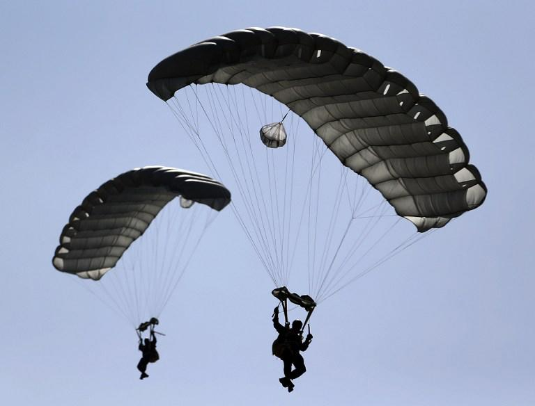 Members of the United Arab Emirates' armed forces perform during the opening ceremony of the International Defence Exhibition and Conference (IDEX) at the Abu Dhabi National Exhibition Centre in the Emirati capital on February 17, 2013.