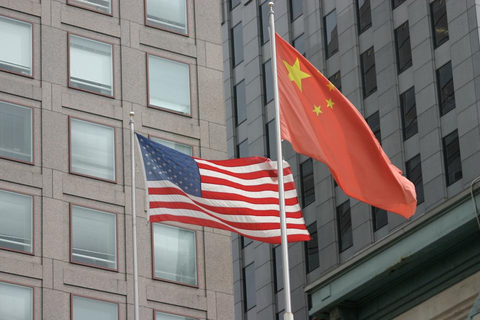 Photo shows US and Chinese flags next to each other. Source: Getty