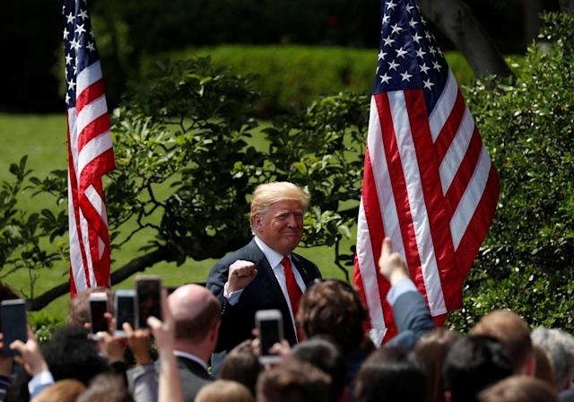 "U.S. President Donald Trump pumps his fist as he departs his ""celebration of America"" event on the South Lawn of the White House in Washington, U.S., June 5, 2018. The event was arranged after Trump canceled the planned visit of the Super Bowl champion Philadelphia Eagles to the White House. REUTERS/Kevin Lamarque"