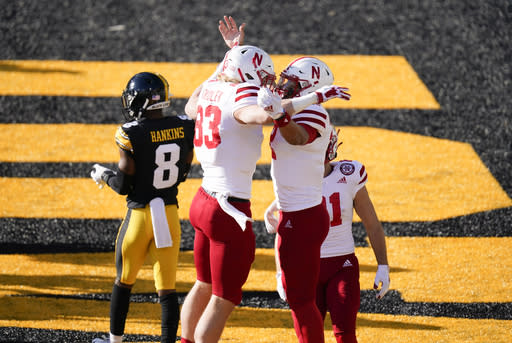 Nebraska quarterback Adrian Martinez, right, celebrates with teammate Travis Vokolek (83) after scoring on a 1-yard touchdown run during the first half of an NCAA college football game against Iowa, Friday, Nov. 27, 2020, in Iowa City, Iowa. (AP Photo/Charlie Neibergall)