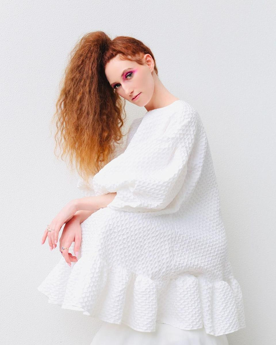 MAFS star Belinda Vickers wearing a white puff sleeve mini dress and her red hair in a high ponytail