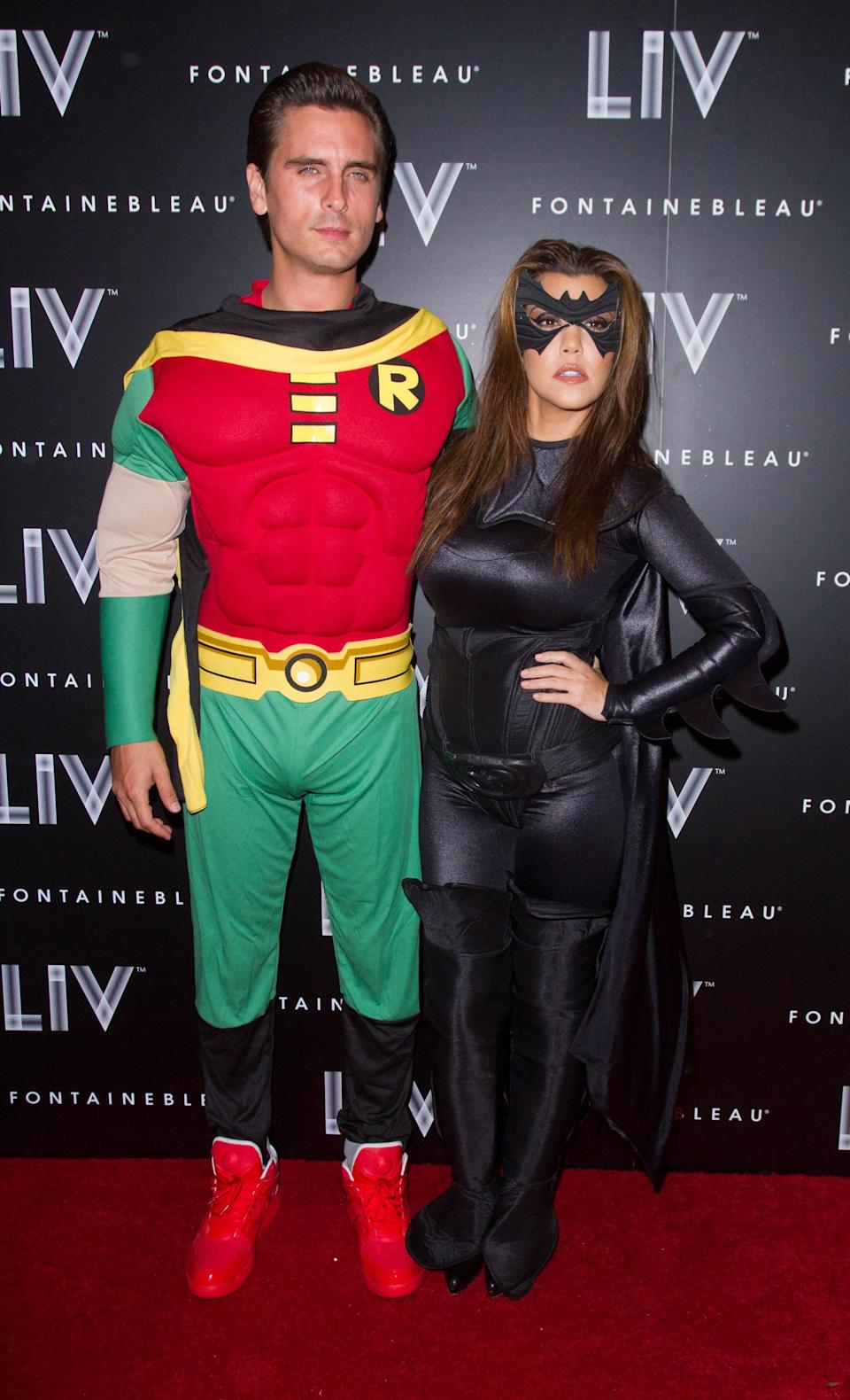 <p>Back in 2012, Kourtney and then-boyfriend Scott Disick attended sister Kim's Hallowen party in Florida. And the pair proved they're not afraid to don couple's costumes and opted to play Batman and Robin. <em>[Photo: Getty]</em> </p>