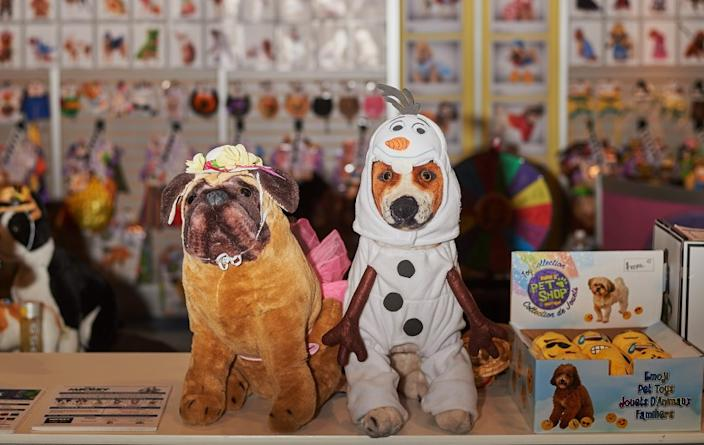 """Pet costumes are displayed on stuffed dogs at the Global Pet Expo in February in Orlando, Fla. <span class=""""copyright"""">(Zack Wittman / For The Times)</span>"""